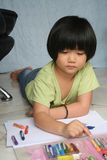 Girl drawing. Little girl doing art painting at home alone Stock Image