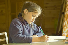 Girl is drawing Stock Photo