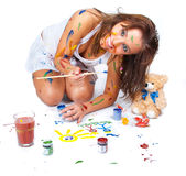 Girl drawing. Happy girl stained in paint drawing dessin Royalty Free Stock Photo