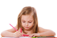 Girl drawing Stock Images