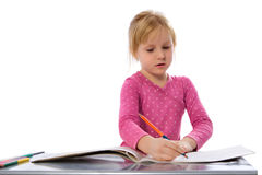 Girl is drawing Stock Photography