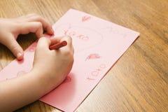 Girl drawing. stock photos