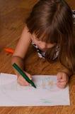 Girl drawing Royalty Free Stock Photo