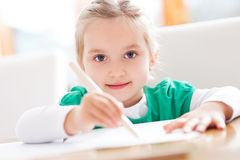 Girl drawing. Little girl drawing a picture royalty free stock photos
