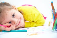 Girl is drawing Royalty Free Stock Image
