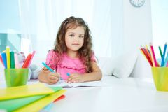 Girl drawing Royalty Free Stock Photo