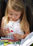 Girl Drawing. Pretty little blond girl colouring in a book Stock Photography