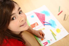 Girl drawing Royalty Free Stock Photos