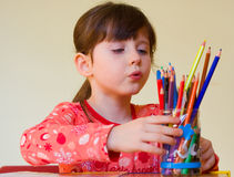 Girl drawing Stock Photo