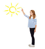 Girl drawing big sun in the air Royalty Free Stock Image