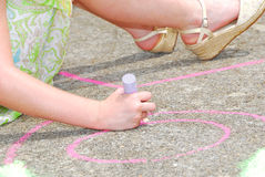 Girl drawing chalk art Stock Photo