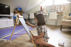 Girl Drawing On Chalkboard In Playroom Royalty Free Stock Image