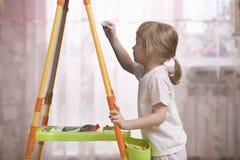 Girl Drawing On Chalkboard Stock Photos