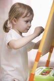 Girl Drawing On Chalkboard Stock Image