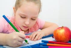 Girl drawing Stock Image
