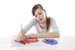 Girl drawing color flower Stock Photos