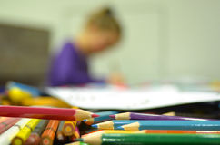 Girl drawing with color pencils Royalty Free Stock Image