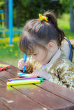 Girl drawing colored markers Royalty Free Stock Photography
