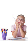 Girl drawing with colored pencils Royalty Free Stock Images
