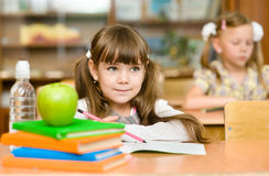 Girl drawing in copybook in classroom Royalty Free Stock Photos