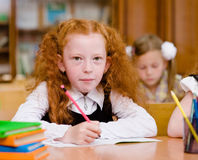 Girl drawing in copybook in classroom Stock Photography