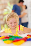 Girl drawing with crayon Royalty Free Stock Photography