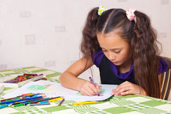Girl drawing with crayons Royalty Free Stock Photo