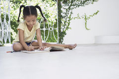 Girl Drawing With Crayons On Porch Stock Photos