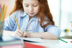 Girl drawing Royalty Free Stock Image