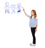 Girl drawing family in the air Stock Images
