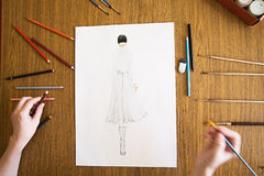 Girl drawing fashion women clothes Royalty Free Stock Images