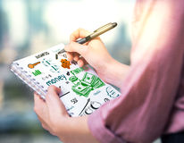 Girl drawing financial sketch. Girl drawing creative financial sketch in notepad. Success concept royalty free stock images