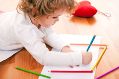 Girl drawing on the floor Royalty Free Stock Photo