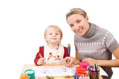 Girl drawing with her mother Royalty Free Stock Image