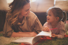Girl drawing with her mother. Royalty Free Stock Photo