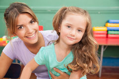 Girl drawing with her teacher royalty free stock photos