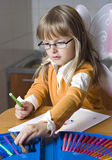 Girl drawing at home Stock Image