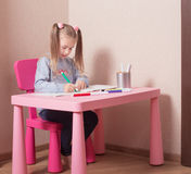 Girl drawing at home. Happy girl drawing at home stock images