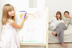 Girl drawing the house Stock Images