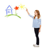 Girl drawing house in the air Stock Photo