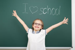 Girl drawing i love school on board Stock Images