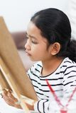 The girl is drawing intently stock photography