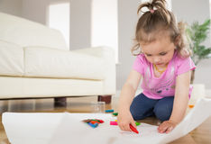 Girl drawing in the living room Royalty Free Stock Photography
