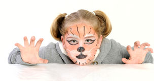Girl with drawing by mask tiger Royalty Free Stock Photo