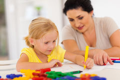 Girl drawing with mother Stock Photo