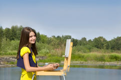 Girl drawing in the open air Royalty Free Stock Images