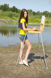 Girl drawing in the open air Stock Photography