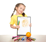 Girl drawing orange on clipboard Stock Photo