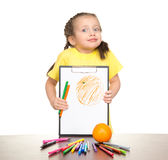 Girl drawing orange on clipboard Stock Image