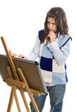 Girl drawing and painting Stock Images
